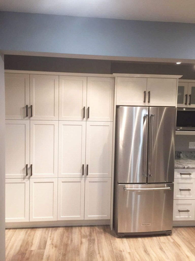 Custom kitchen renovation with floor-to-ceiling cabinets