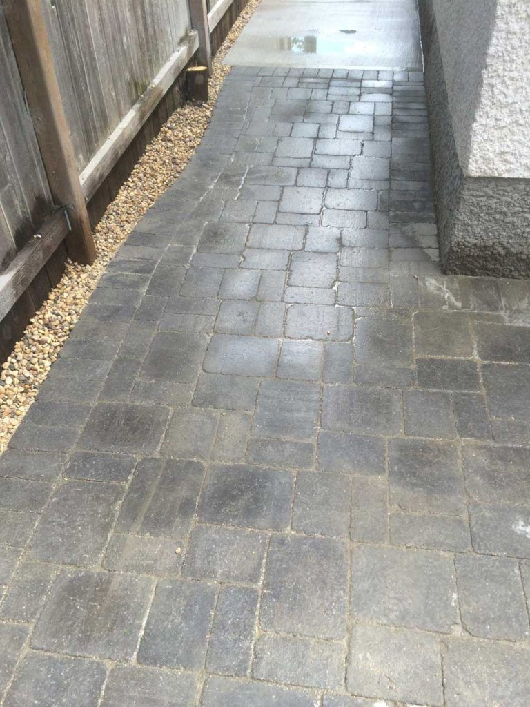 intricate stone interlock pattern on a back yard patio