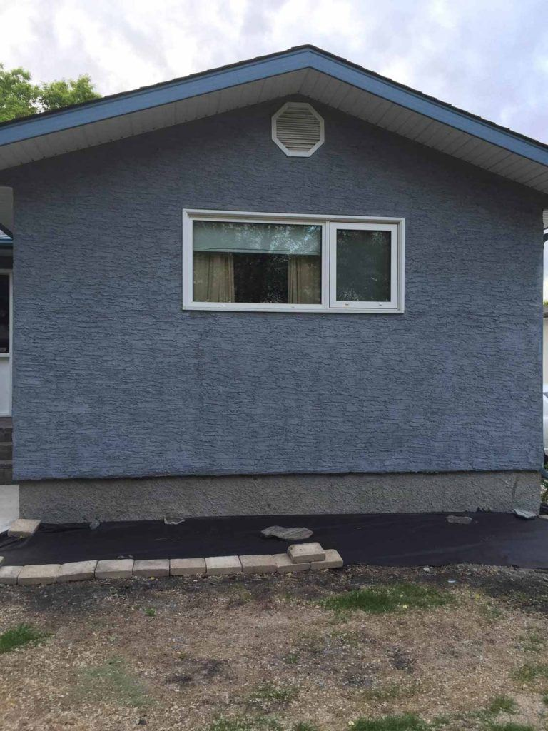 Exterior blue stucco in knockdown style