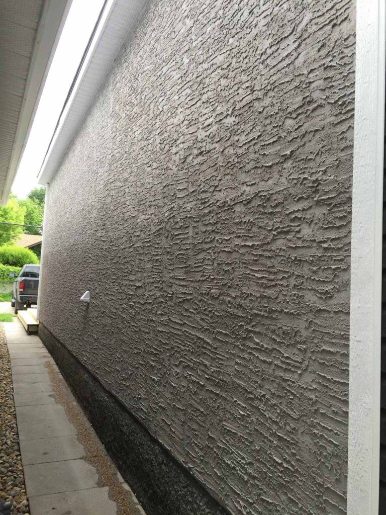 Exterior stucco on a home wall in knockdown style