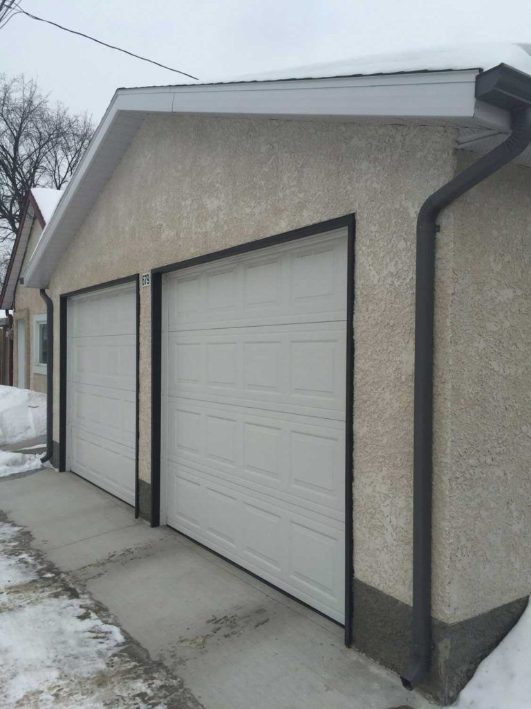 Exterior stucco on a garage wall in knockdown style