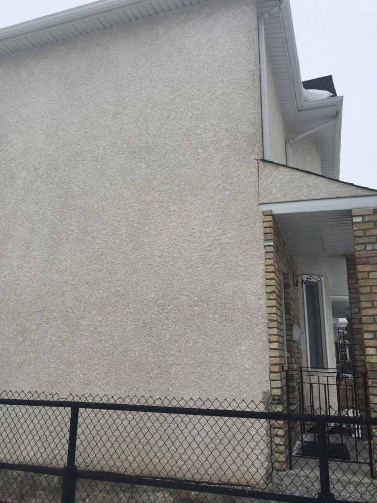 Exterior stucco on a home wall in popcorn style