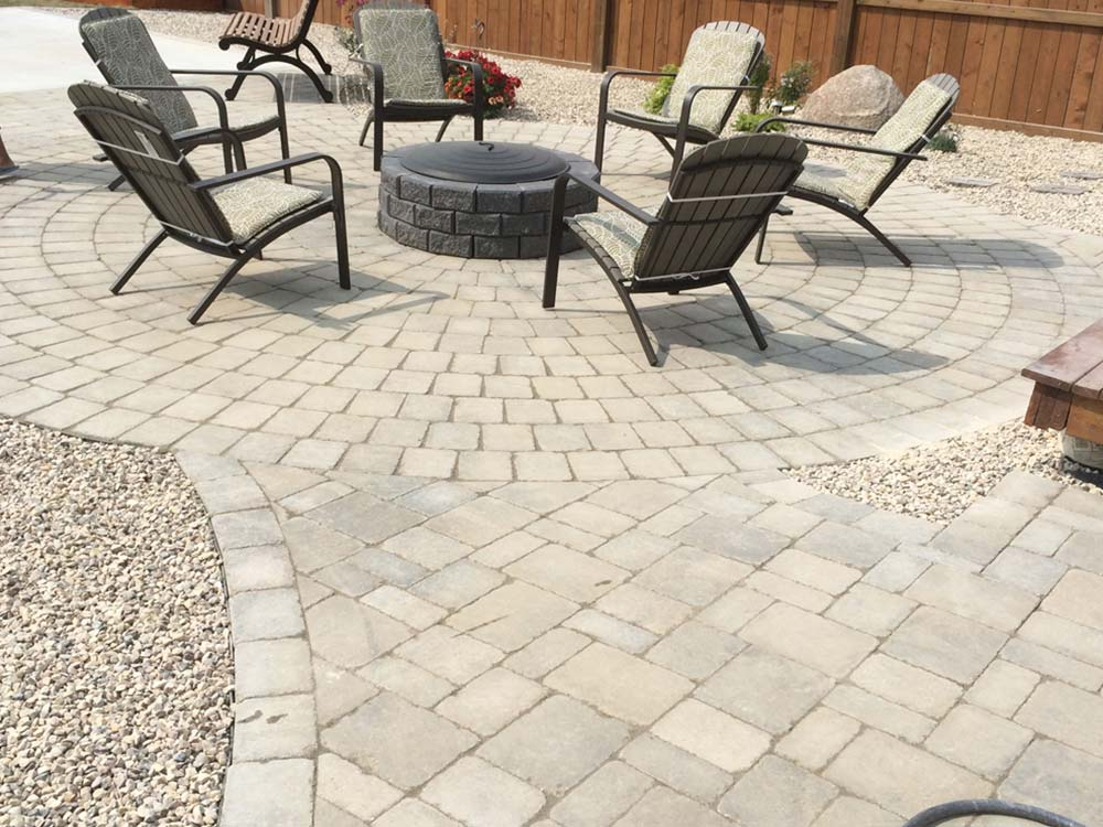 circular interlocking stone backyard patio space and fire pit