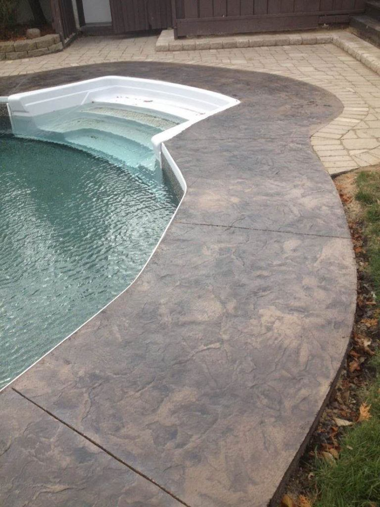 Stamped and coloured concrete surrounding exterior pool
