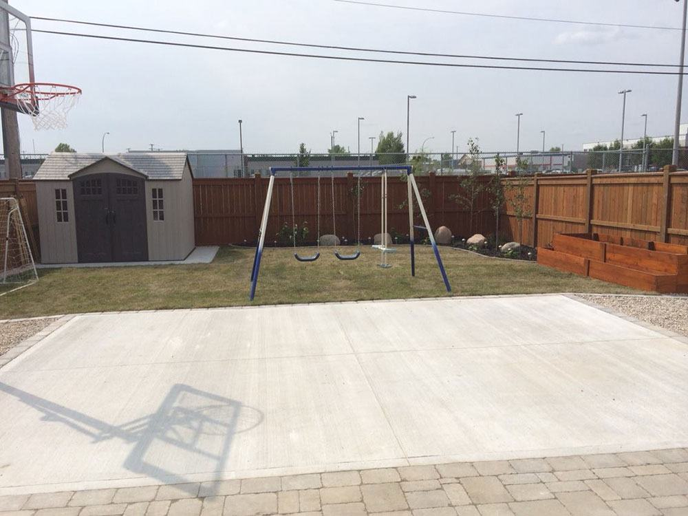Expert backyard concrete basketball court installation