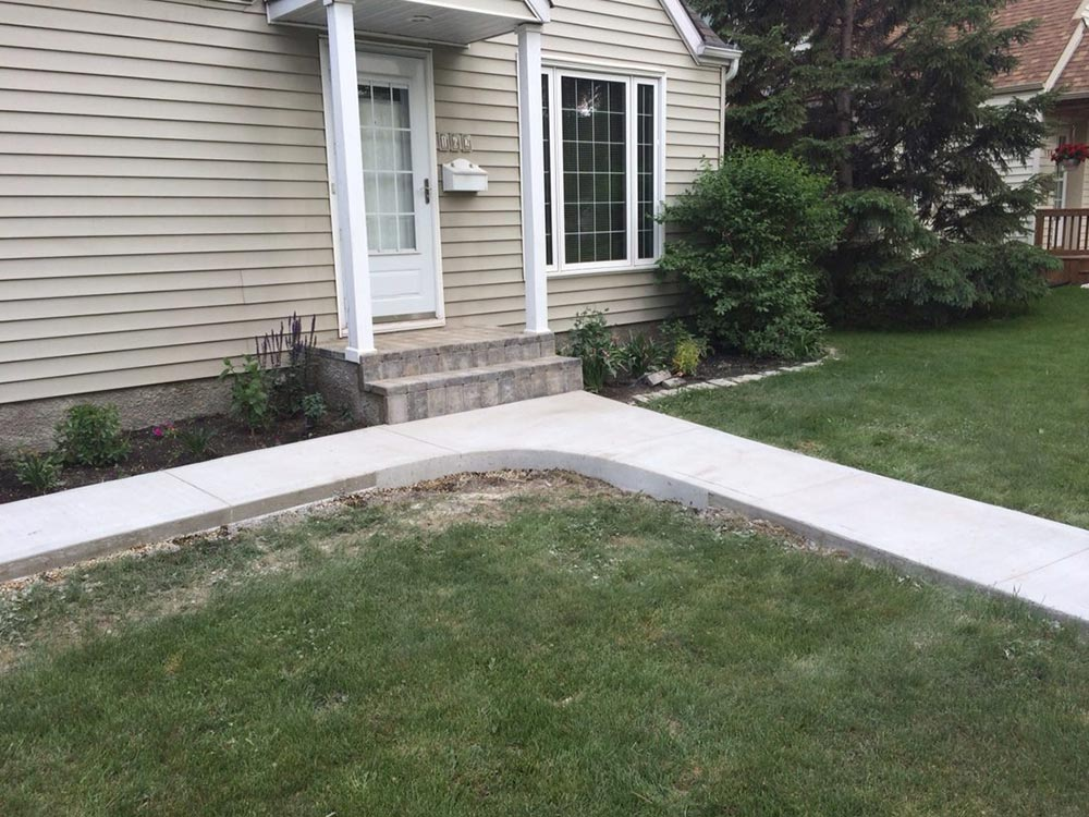 High-quality concrete walkway in front of a residential home