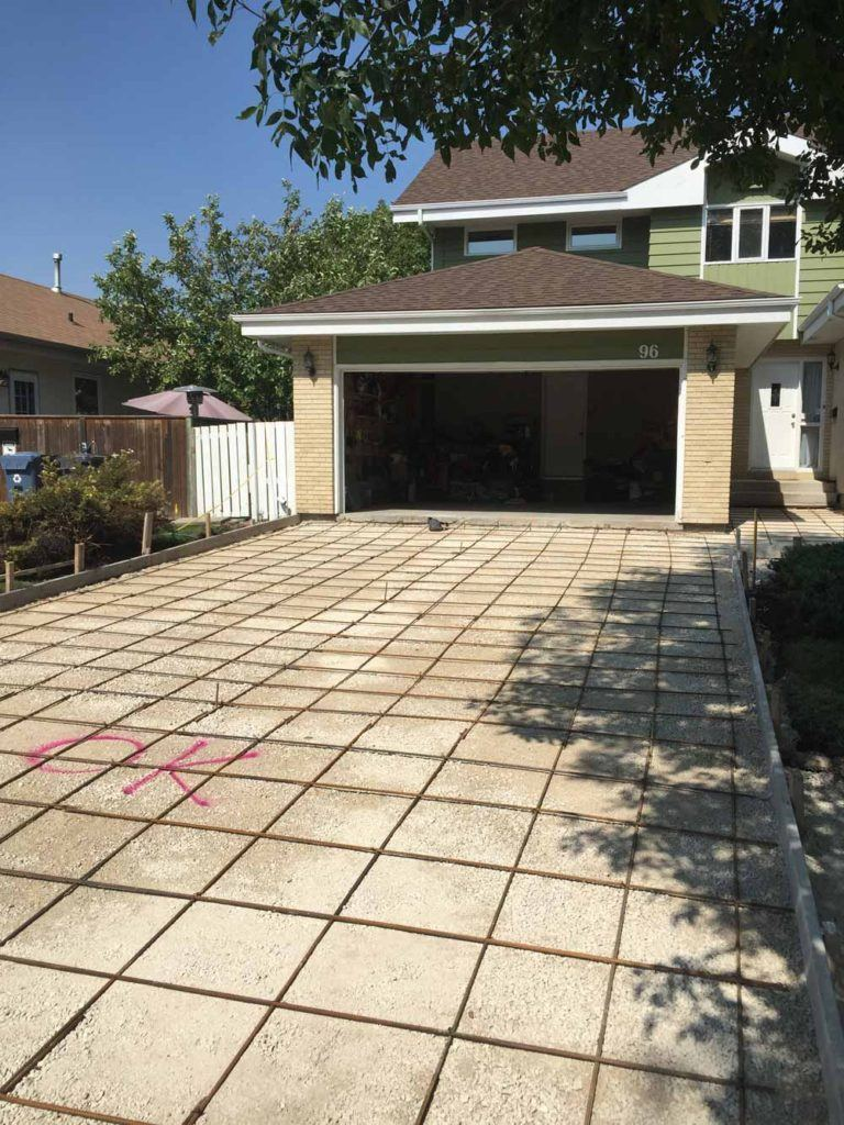 a new concrete driveway before pouring with a rebar reinforcement grid