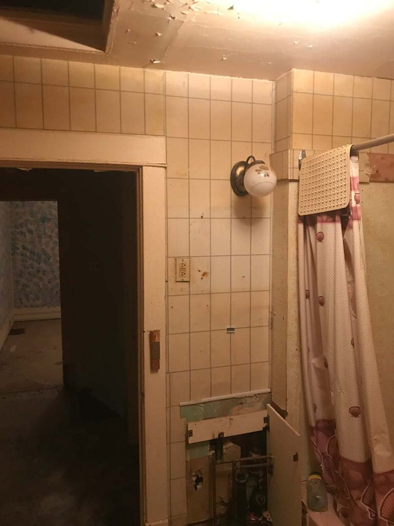 a dim and outdated basement bathroom prior to a modernizing home renovation