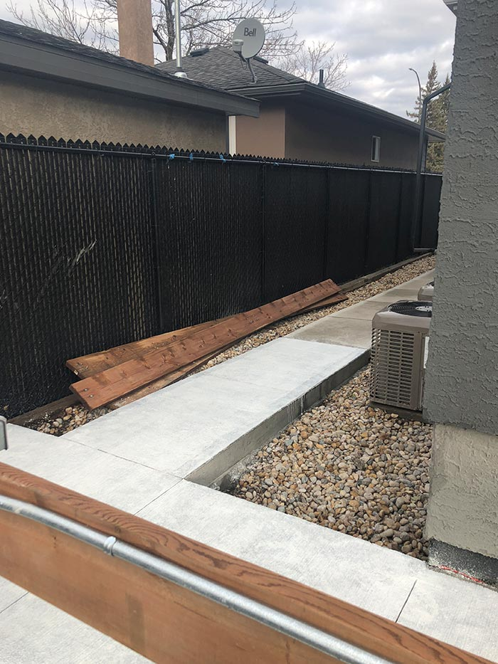 a new concrete walkway outside of a residential home