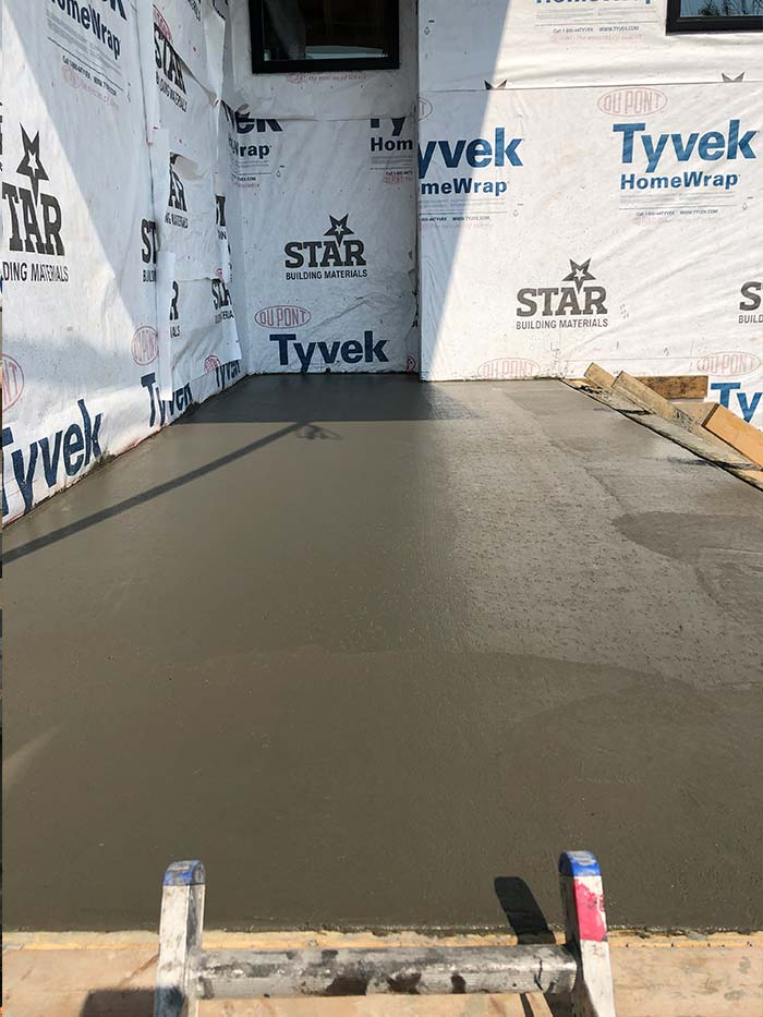 Custom concrete entrance platform outside of a commercial space being built