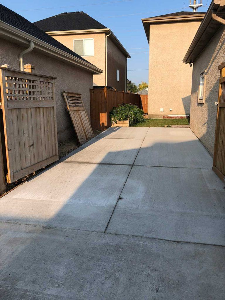 a concrete slab driveway outside of a residential home