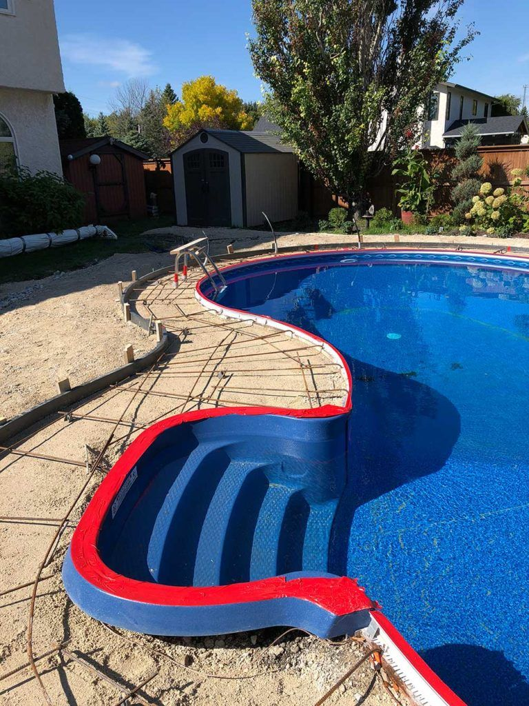 a new in-ground pool installation in progress with a grid of rebar awaiting concrete