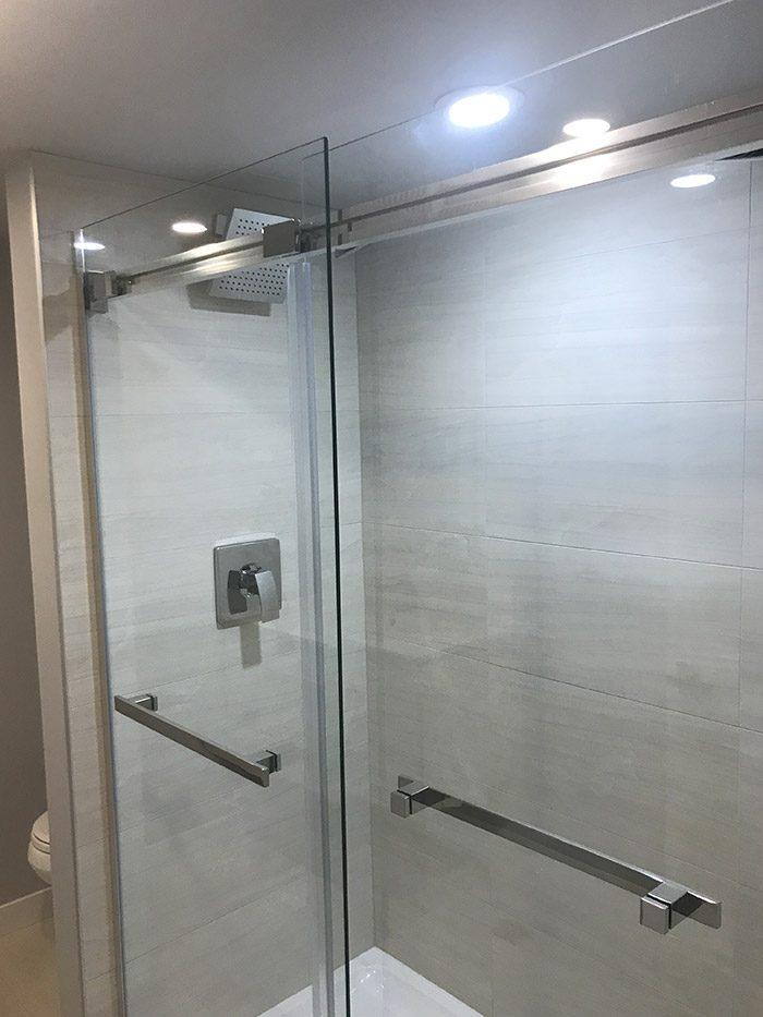 stainless steel framed glass shower door