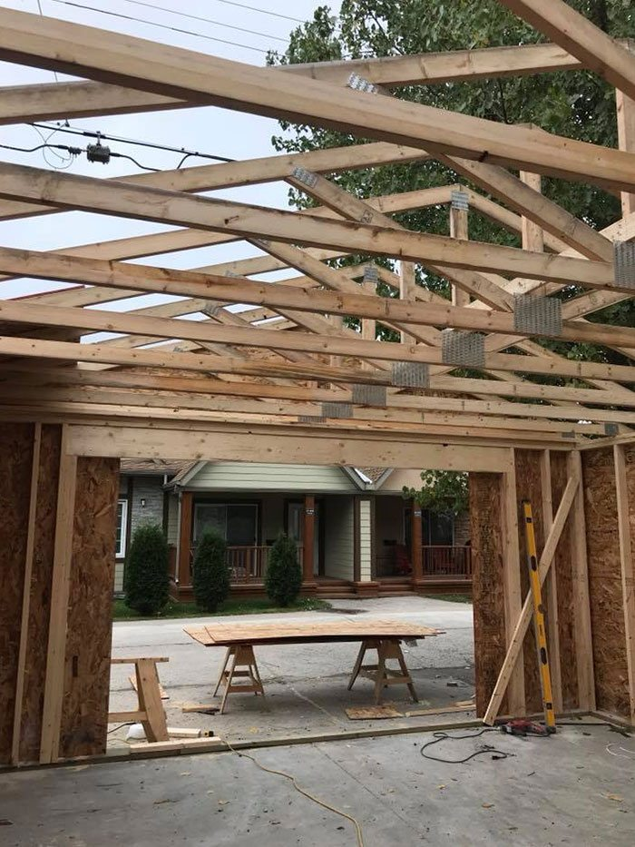 a new residential garage build in progress with wood roof beams