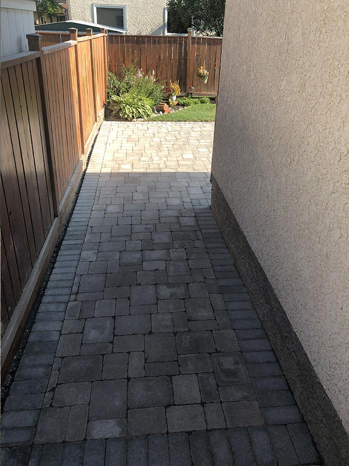 interlock walkway and patio behind a residential home