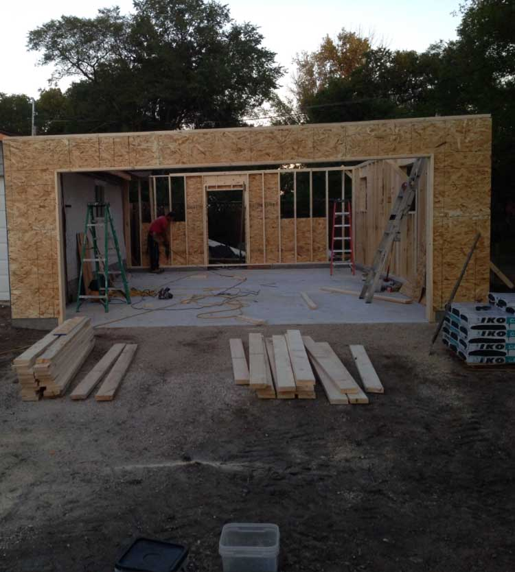 a residential garage build in progress with an extra wide garage door opening