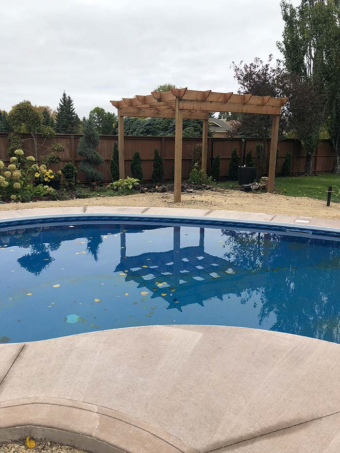 a new concrete deck around a backyard pool
